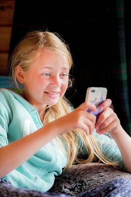 Candid Photograph - Girl Using A Smartphone by Samuel Ashfield