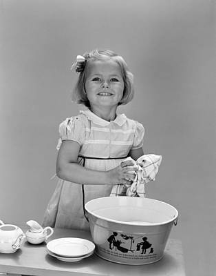 Girl Washing Dishes And Smiling, C.1940s Art Print by H. Armstrong Roberts/ClassicStock