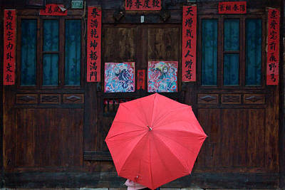 Couplet Photograph - Girl With Red Umbrella Watching by Keren Su