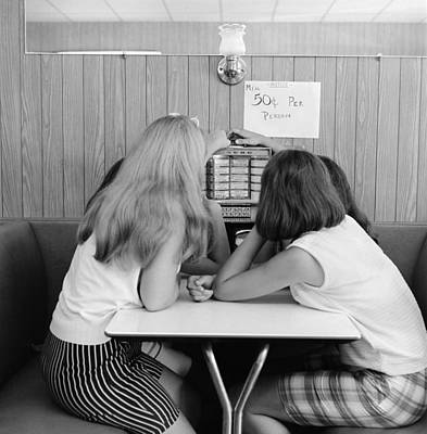 Girls Operating Small Juke Box, C.1960s Art Print by H. Armstrong Roberts/ClassicStock