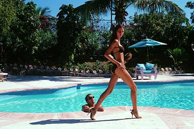 Daytime Photograph - Gisele Bundchen Walking Poolside by Arthur Elgort
