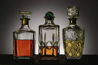 Row Of Bottles Photograph - Glass And Crystal Decanters Containing by Paul Damien