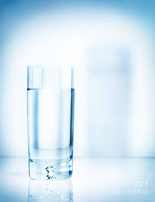 Photograph - Glass Of Water On Light Blue Background by Oleksiy Maksymenko