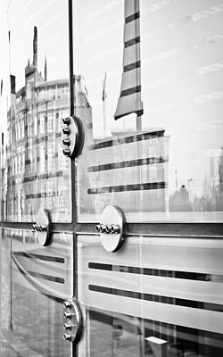 Glass Panels And Reflections Art Print by Tom Gowanlock