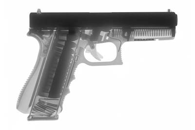 X-ray Photograph - Glock G17 by Ray Gunz