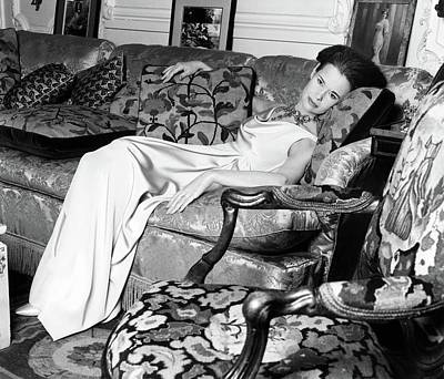 Of Artist Photograph - Gloria Vanderbilt Reclining On A Couch by Horst P. Horst