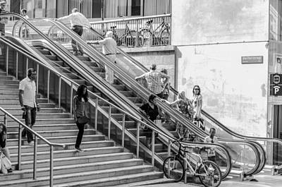 Almere Photograph - Going Up And Down And Sitting On The Stairs Phoning by Paul Donohoe