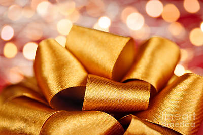 Giving Photograph - Gold Gift Bow With Festive Lights by Elena Elisseeva