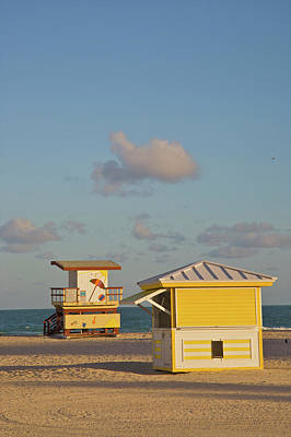 Photograph - Golden Sun Hitting Beach Structures And by Barry Winiker