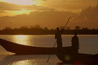 Golden Sunset Two Fishermen Enjoy The Evening After Days  Hardwork Art Print by Navin Joshi
