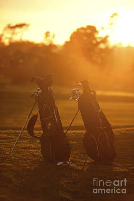 Sports Royalty-Free and Rights-Managed Images - Golf bags at sunset by Diane Diederich