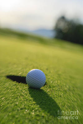Photograph - Golf Ball About To Drop In The Hole. by Don Landwehrle