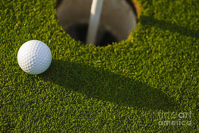 Photograph - Golf Ball Inches From The Cup by Don Landwehrle