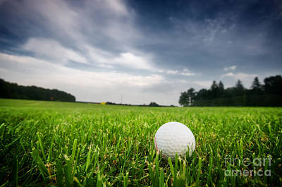 Game Photograph - Golf Ball On On The Field by Michal Bednarek