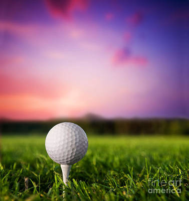 Sports Royalty-Free and Rights-Managed Images - Golf ball on tee at sunset by Michal Bednarek