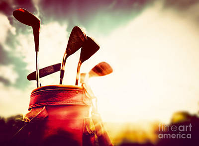 Course Photograph - Golf Clubs In A Leather Baggage In Vintage Retro Style At Sunset by Michal Bednarek