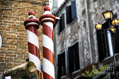 Photograph - Gondola Poles In Venice by John Rizzuto