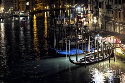 Photograph - Gondolas At Night by John Rizzuto