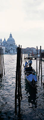 Gondolier In A Gondola With A Cathedral Art Print by Panoramic Images