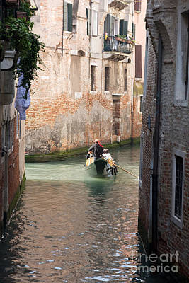 Gondolier In Venice Print by Gabriela Insuratelu