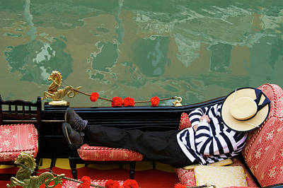 Young Adult Photograph - Gondolier Resting In Gondola by Brent Winebrenner