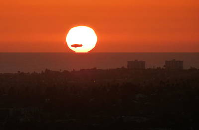 Photograph - Goodyear Blimp Sun Silhouette by Jeff Lowe
