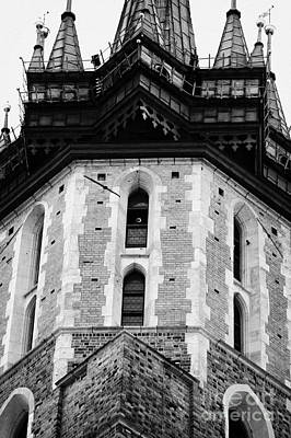 Cracovia Photograph - Gothic Tower Of The 14th Century Gothic Basilica Of The Virgin Mary S With Trumpeter Playing The Krakow Hourly Trumpet Signal by Joe Fox