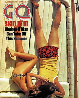 Photograph - Gq Cover Of Couple Lying Face Down On Boat Deck by Douglas Mesney