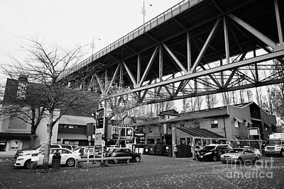 Granville Island Photograph - granville island public market underneath granville bridge Vancouver BC Canada by Joe Fox