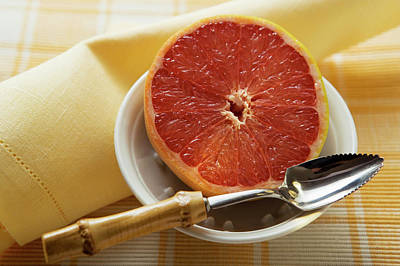 Grapefruit Photograph - Grapefruit Half With Grapefruit Spoon In A Bowl by Foodcollection