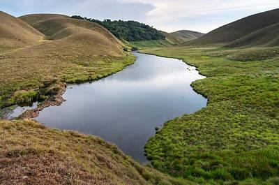 Rustic Scenes Photograph - Grassy Hills And Lake by K Jayaram