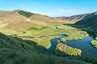 Rustic Scenes Photograph - Grassy Hills And Wetlands by K Jayaram