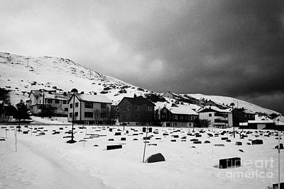 gravestones partially buried in the snow in the cemetery outside Honningsvag kirke church norway Art Print by Joe Fox