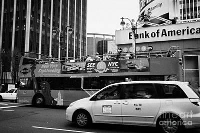 Gray Line New York Sightseeing Bus And Yellow Mpv Taxi Cab On 7th Avenue New York City Art Print by Joe Fox