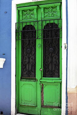 Green Door In Bogota Print by John Rizzuto
