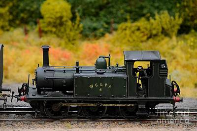 Photograph - Green Weathered Steam Engine With Driver Model Train by Imran Ahmed