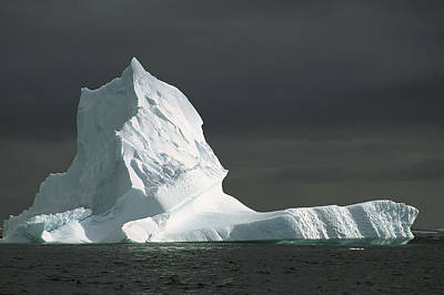 Grounded Iceberg With Storm Clouds Art Print