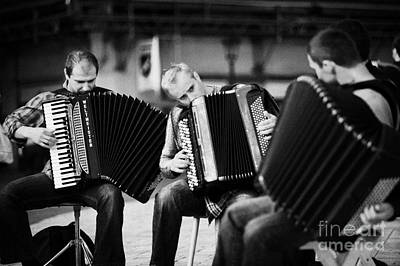 Group Of Accordion Players Perform In The Street In Rynek Glowny Town Square Krakow Art Print by Joe Fox