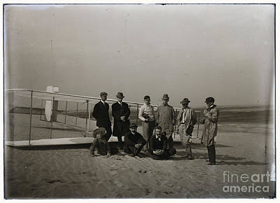 Photograph - The Wright Brothers Group Portrait In Front Of Glider At Kill Devil Hill by R Muirhead Art