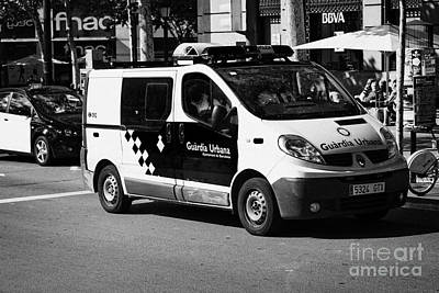 Police Van Photograph - Guardia Urbana Police Patrolling City Centre Of Barcelona Catalonia Spain by Joe Fox