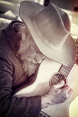 Working Cowboy Photograph - Guitar Man by Steven Bateson