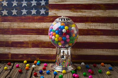 Room Wall Art - Photograph - Gumball Machine And Old Wooden Flag by Garry Gay