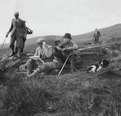 Gurnee Munn And Gurnee Munn Jr. Sitting On Grassy Art Print by John Mcmullin