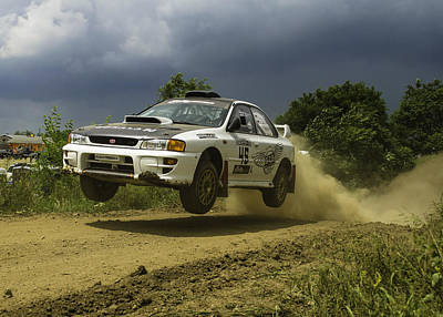 Photograph - Gzb Rally Team In Flight by Jason Massey