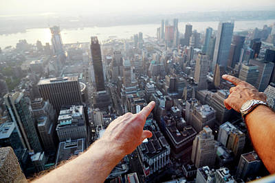 Hands Pointing At City As Seen From Art Print by Chris Tobin