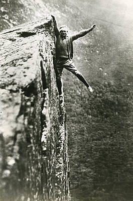 With Photograph - Hanging Off Cliff by Retro Images Archive