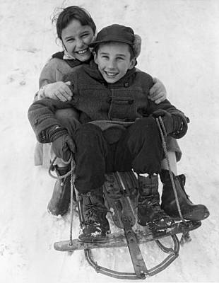 Happy Children On A Sled Art Print by Underwood Archives