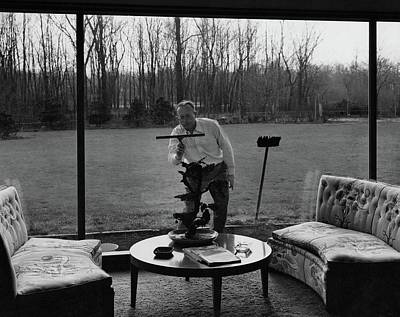 Coffee Table Photograph - Harold M Sloan Cleaning A Glass Wall by Hedrich Blessing