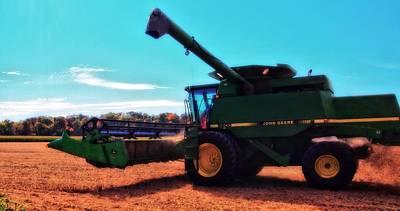 Photograph - Harvest Season On John Deere by Dan Sproul