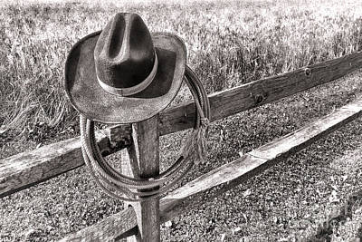 Fencepost Photograph - Hat And Lariat by Olivier Le Queinec